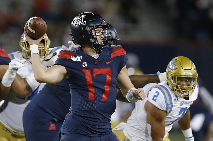 Arizona quarterback Grant Gunnell (17) throws against UCLA in the first half of an NCAA college football game, Saturday, Sept. 28, 2019, in Tucson. (Rick Scuteri/AP)