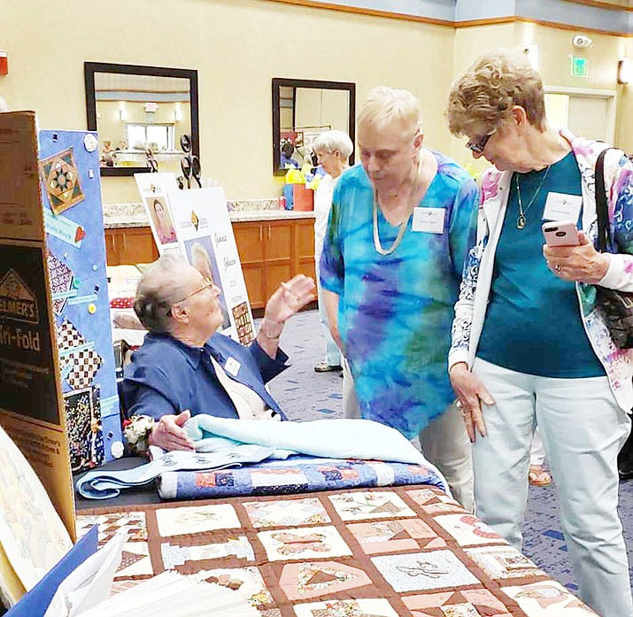 Jimmie Johnson showing off some of her many quilts at a booth at the event in Phoenix last weekend. (Jimmie Johnson/Courtesy)