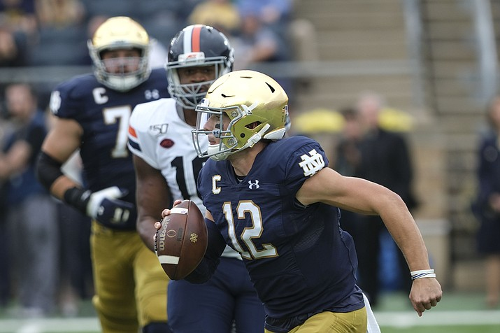 Notre Dame quarterback Ian Book (12) runs with the ball against Virginia in the first half of an NCAA college football game in South Bend, Ind., Saturday, Sept. 28, 2019. (AJ Mast/AP)