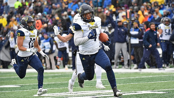 Northern Arizona University senior linebacker Taylor Powell returns an interception for a touchdown on Saturday against Montana State University in Bozeman, Mont. NAU surrendered a 17-point lead and lost 49-31. (Northern Arizona University athletics department photo)