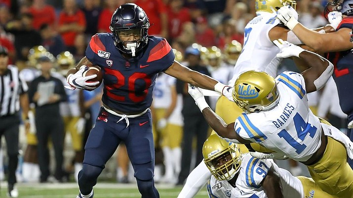 Arizona red-shirt freshman running back Bam Smith carries the ball in the Wildcats 20-17 win over UCLA on Saturday. Smith had 134 total yards, including a 75-yard touchdown reception. (Arizona Athletics Department photo)