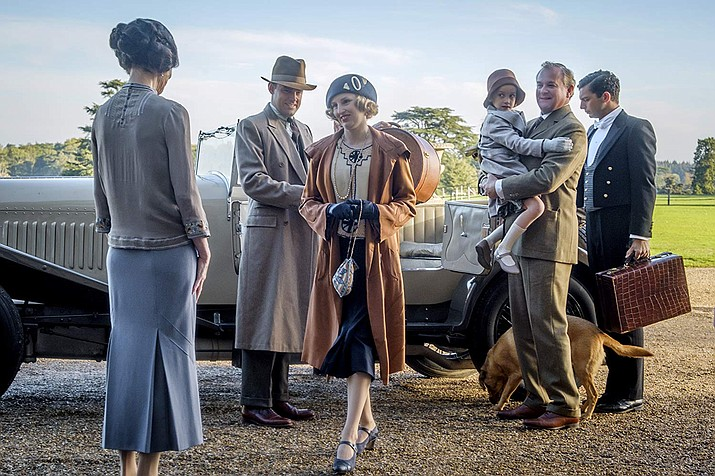 Elizabeth McGovern, Hugh Bonneville, Harry Hadden-Paton, Laura Carmichael and Michael Fox are seen in a scene from Downton Abbey (2019). (IMDb photo)