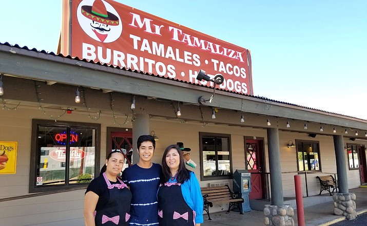 The Gonzalez family: Claudia, Leonardo, and Tanya in front of their newly acquired restaurant, Mr. Tamaliza, next to Chase Bank on SR 179. Photo by The Dunnery
