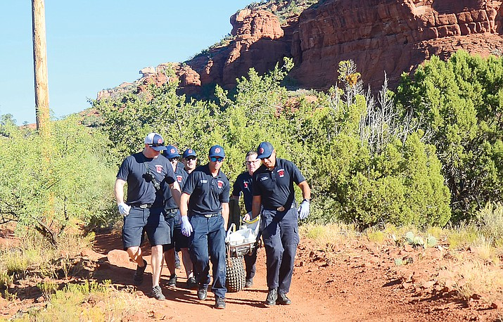 A local hiker found an unconscious mountain biker on the Chimney Rock Trail on Tuesday morning, called 911, and performed CPR until Sedona Fire and others arrived to carry him down the trail. VVN / Vyto Starinskas