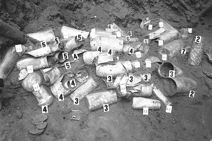 This 1996 photo provided by the American Museum of Natural History, shows an excavation site showing pottery vessels at Pueblo Bonito, Chaco Canyon, New Mexico. One pottery sherd at a time, archaeologist Patricia Crown has been working to unravel the mystery of chocolate and its importance to a civilization that once inhabited Chaco Canyon, believed to be a ceremonial and economic hub for indigenous people in what is now the American Southwest. Her discoveries over the last decade have shed more light on the widespread use of cacao across the region and the extent of early trade routes with Mesoamerica. But, she says, when it comes to Chaco, each discovery leads only to more questions that archaeologists and anthropologists need to answer. (American Museum of Natural History via AP)