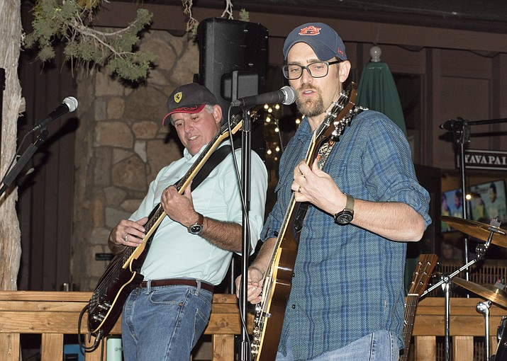 "The Boulder Alley Boys has made a name for itself playing at local venues at the Grand Canyon. At one time, Mike Slagle (left) played in a professional house band and won ""battle of the bands"" as the youngest act. According to Courtney Dixon (right), Slagle also had a brief encounter with Eric Clapton. (Veronica R. Tierney/WGCN)"