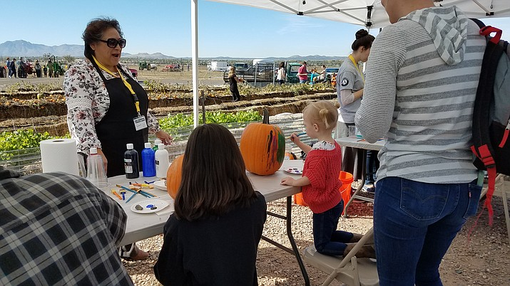 Festival attendees paint pumpkins during the 2018 Harvest Festival in Chino Valley. (CV Chamber of Commerce/Courtesy)