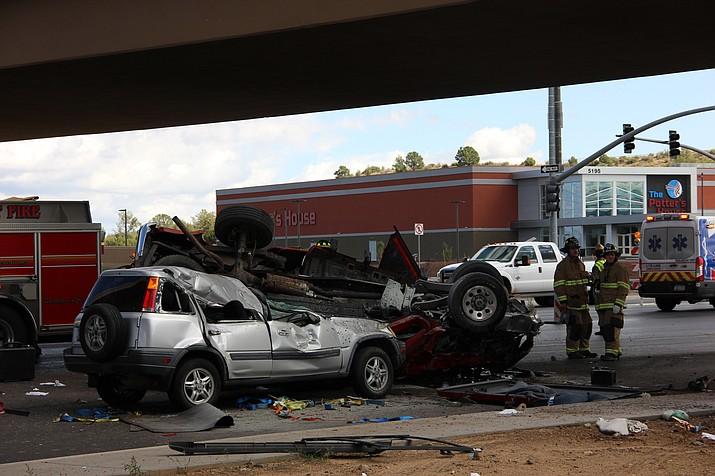 A red truck and silver compact SUV lie battered in the southbound lane of Highway 89 Friday afternoon, Sept. 27, 2019. (Max Efrein/Courier)