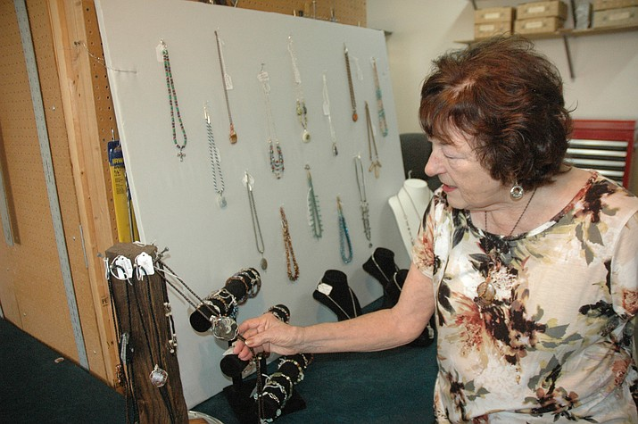 Chino Valley artist Jane Heckel shows off some of her work prior to the 12th annual Prescott Area Artist Studio Tour which is Friday through Saturday, Oct. 4-6. Studios are open from 10 a.m. to 4 p.m. Heckel will be demonstrating jewelry design, kumihimo and wire wrapping.  (Jason Wheeler/Courier)