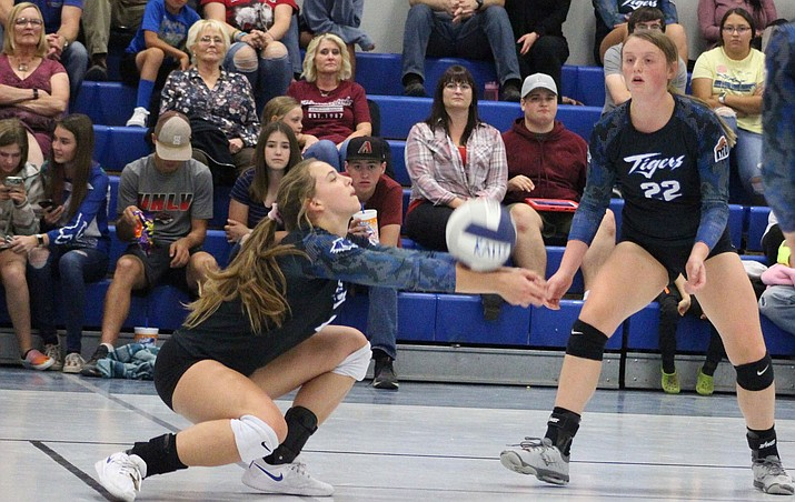 Kingman Academy's Lynsey Day makes a pass as Kirsta Thomson watches Tuesday night in a 3-1 win over Kingman High. (Photo by Beau Bearden/Daily Miner)