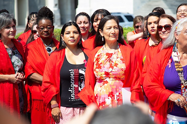 Rep. Deb Haaland, D-N.M. stands with a group of women who were rallying at the Capitol for the reauthorization of the Violence Against Women Act. (Photo by Harrison Mantas/ Cronkite News)