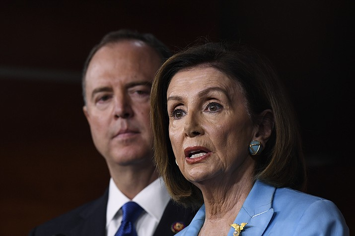 House Speaker Nancy Pelosi of Calif., joined by House Intelligence Committee Chairman Rep. Adam Schiff, D-Calif., speaks during a news conference on Capitol Hill in Washington, Wednesday, Oct. 2, 2019 (Susan Walsh/AP)