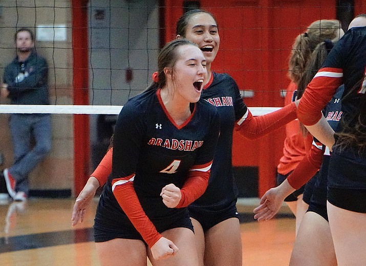 Bradshaw Mountain MH Peyton Bradshaw (4) and OH Mailani Manuel celebrate after scoring a point during the team's 3-1 win over Coconino on Tuesday, Oct. 1, 2019, at Bradshaw Mountain High School. (Aaron Valdez/Courier)
