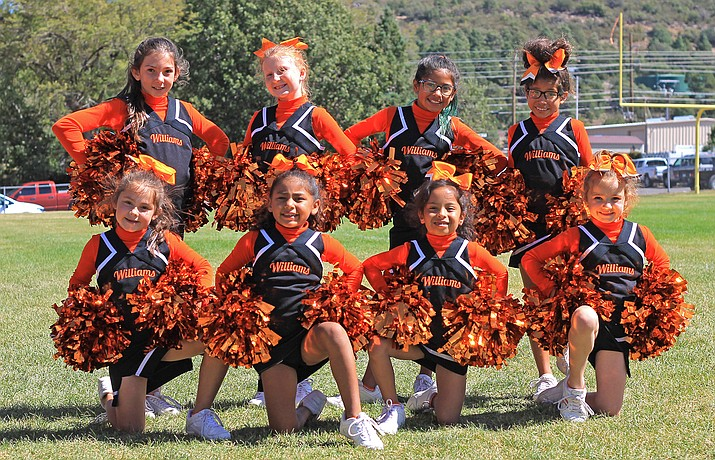 The Williams Youth Cheer team fired up the crowd at the Bengals - Panthers football game Sept. 28. The team includes from top left: Sarah McCloy, Faith Jensen, Haylie Lopez and Sonia Lopez. Bottom row: Joslin Uebel, Kyra Palafox, Litzy Urias, and Ariah Sneed. (Wendy Howell/WGCN)