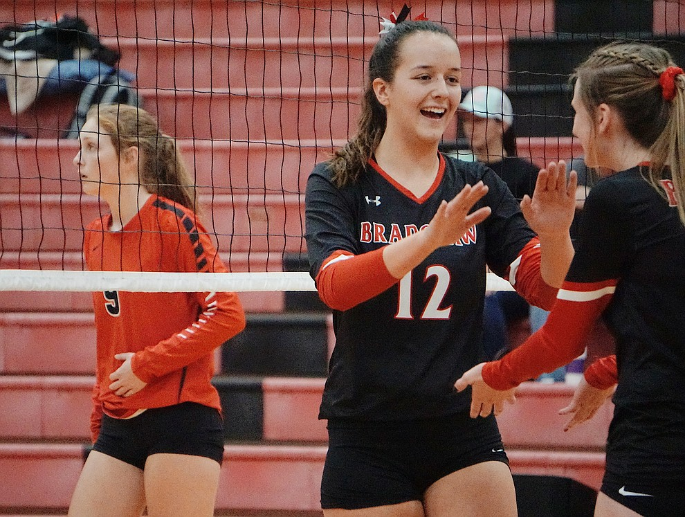Bradshaw Mountain MH Sydney Rittershaus (12) hi-fives MH McKyrie Herb during the team's 3-1 win over Coconino on Tuesday, Oct. 1, 2019, at Bradshaw Mountain High School. (Aaron Valdez/Courier)