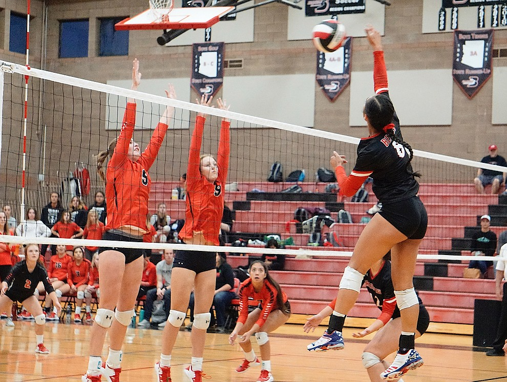 Bradshaw Mountain OH Mailani Manuel (8) jumps up to make the kill during the team's 3-1 win over Coconino on Tuesday, Oct. 1, 2019, at Bradshaw Mountain High School. (Aaron Valdez/Courier)
