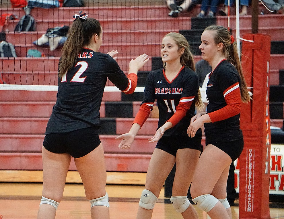 Bradshaw Mountain OH Abigail Platt (11) hi-fives MH Sydney Rittershaus (12) after scoring a point during the team's 3-1 win over Coconino on Tuesday, Oct. 1, 2019, at Bradshaw Mountain High School. (Aaron Valdez/Courier)