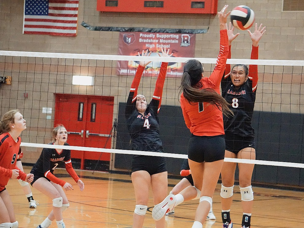 Bradshaw Mountain OH Mailani Manuel (8) and MH Peyton Bradshaw (4) go up for the block during the team's 3-1 win over Coconino on Tuesday, Oct. 1, 2019, at Bradshaw Mountain High School. (Aaron Valdez/Courier)