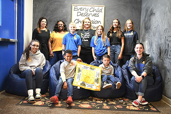 Students helping to fight childhood cancer include, back row from left, Serena Patterson, Nikita Deffendoll, Spencer Lindsay, Nancy Villanueva, Alana Garibaldi, Isabella Frisby and Maysen Victory. Front row: Teagan Mosby, Grant Deffendoll, Tyler Patterson and Kayla Foster. (Daily Miner photo)