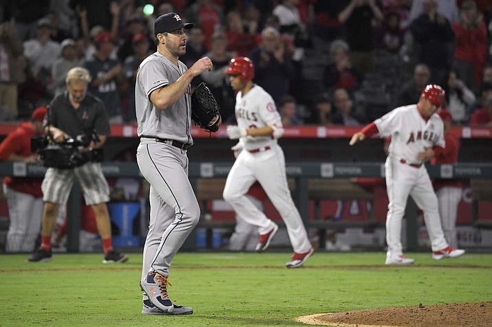 Houston Astros starting pitcher Justin Verlander, second from left, walks back to the mound after giving up a two-run home run to Los Angeles Angels' Andrelton Simmons, second from right, during a game Saturday, Sept. 28, 2019, in Anaheim, Calif. (Mark J. Terrill/AP)