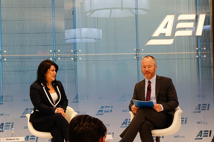 Arizona Treasurer Kimberly Yee talks about the state's Empowerment Scholarship Account program with the American Enterprise Institute's Nat Malkus at an AEI event about a federal school choice plan. (Photo by Amy-Xiaoshi DePaola/Cronkite News)