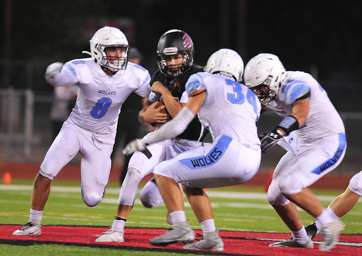 Bradshaw Mountain's Josh Grant tries to run through the defense as the Bears host Estrella Foothills in their 2019 football home opener Friday, Aug. 23, 2019, in Prescott Valley. (Les Stukenberg/Courier, File)