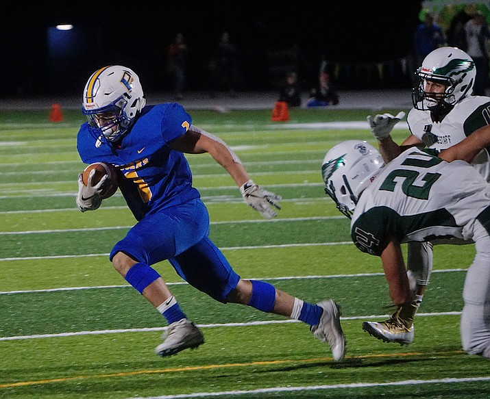 Prescott RB Sylas Espitia (1) runs the ball around the defense during the team's 48-7 win over Flagstaff on Friday, Sept. 20, 2019, at Bill Shepard Field in Prescott. (Aaron Valdez/Courier, File)