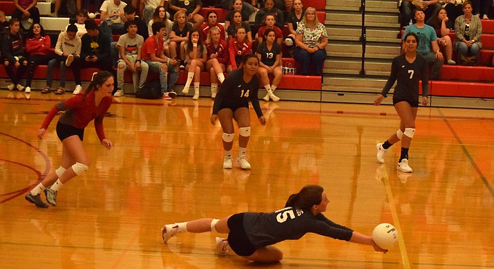 Mingus senior Jenna Mahon dives to try and get a dig during the Marauders' 3-1 loss to Lee Williams on Tuesday night at home. VVN/James Kelley