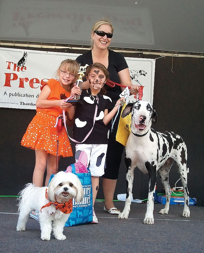 Prescott 5th Annual Dogtoberfest winners. Best Trick, Stefanie Goldstein and her dog Rudi. Best Owner Look-alike, Abby Derks and her dog Lola. Both girls are 7 years old and residents of Prescott. (Allison Goldstein/Courtesy)
