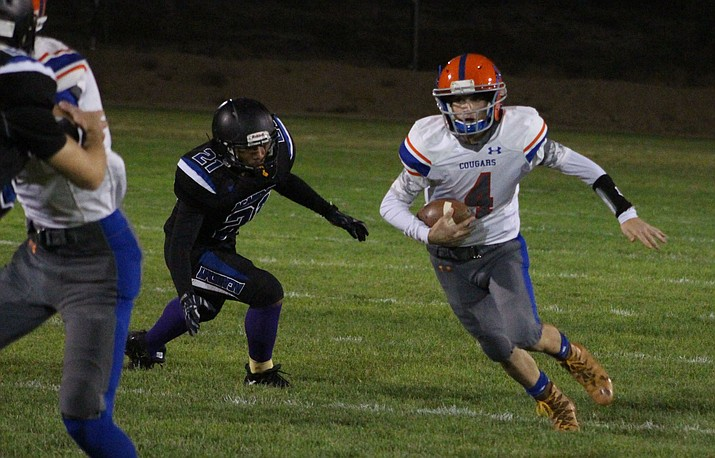 Chino Valley sophomore RB Jaxton Mortensen (4) runs in a nine-yard touchdown after making a catch during team 27-26 loss to Kingman Academy on Friday, Oct.4, 2019, in Kingman. (Beau Bearden/Kingman Daily Miner)