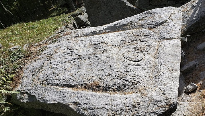 This photo released Thursday, Oct. 3, 2019, by the Salem, N.H. Police Department shows vandalism to a stone in group of rock configurations called America's Stonehenge in Salem, N.H. The vandalism was reported to the police Sunday by the property's owners. (Salem Police Department via AP)