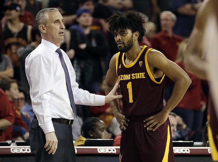 """In this Jan. 26, 2019, photo, Arizona State coach Bobby Hurley, left, talks to guard Remy Martin during the second half of the team's game against USC in Los Angeles. The Sun Devils won their first NCAA Tournament game in a decade by beating St. John's in the First Four last year before losing to Hurley's former team, Buffalo. Now they want more. """"Even though we've done a good amount, I'm still not satisfied, I still want to make it further,"""" Martin said. """"For those guys that left, they did great but we're here now and we've got to figure out how to win."""" (AP Photo/Marcio Jose Sanchez, File)"""
