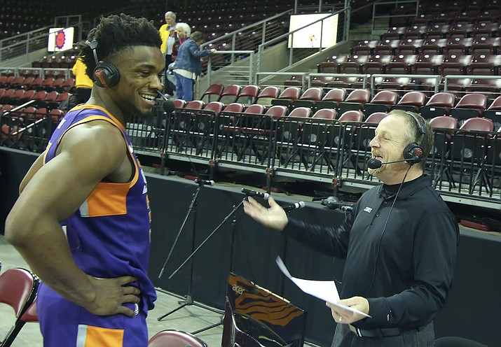 Northern Arizona Suns play-by-play broadcaster Jon Bloom talks with Retin Obasohan a season ago. Bloom is getting his own call-up to the NBA, taking a larger role with the Phoenix Suns' broadcast team. He could potentially call 25 games on the radio this season for the Suns in place of Hall of Fame broadcaster Al McCoy, who enters his 48th season calling Phoenix games in 2019-2020. (NAZ Suns/Courtesy)