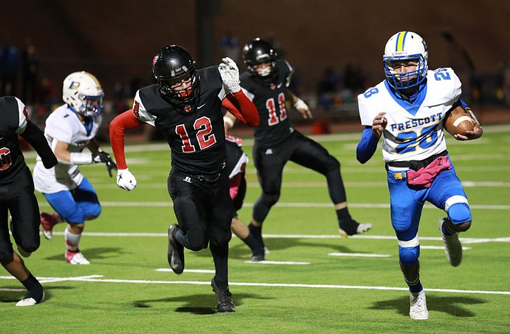 Prescott's Dellin Boyd (28) runs for a first down against Coconino on Friday, Oct. 4, 2019, in Flagstaff. The Badgers lost 34-27. (Daily Sun/Courtesy)