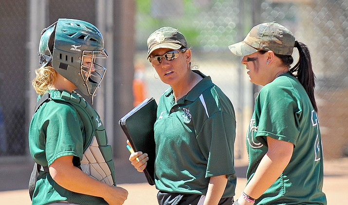 Head Coach Stacey Iveson talking with pitcher Alex Landon (22) and catcher Ashleigh Seipl (8) after Landon gave up six runs in the second inning of a game against Pima on April 26, 2011. (Courier File Photo)