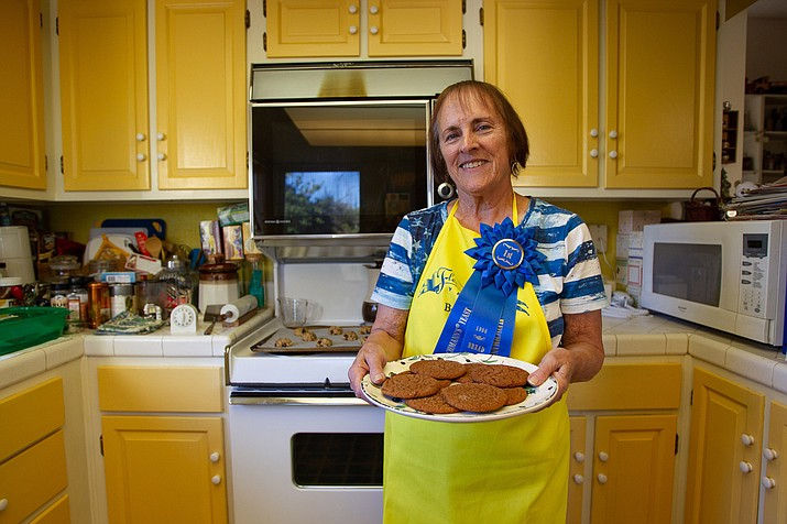 This photo taken Sept. 30, 2019, shows Mary Jane McHenry, who has competed in the Arizona State Fair cooking contest 45 years in a row. McHenry will be bringing food like cookies, muffins and focaccia made with rosemary from her garden. (Carly Bowling/The Arizona Republic via AP)