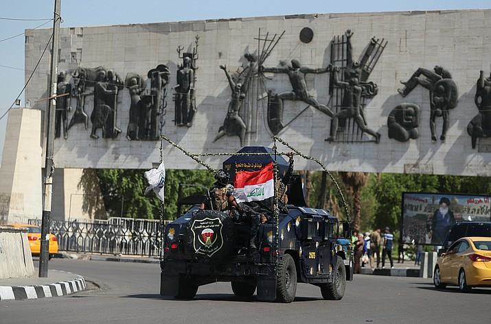 Iraqi security forces arrive near the site of the protests in Tahrir square, central Baghdad, Iraq, Saturday, Oct. 5, 2019. Curfew has been lifted Saturday in the Iraqi capital, days after authorities imposed it in an attempt to quell anti-government demonstrations that have turned deadly. Officials say at least 64 were killed in the four-day protests that have rocked the capital and southern cities. (AP Photo/Hadi Mizban)