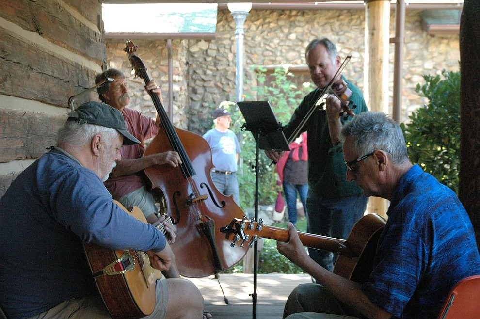 Musicians spontaneously get together and jam during the 41st annual Folk Music Festival Saturday, Oct. 5, 2019. The festival continues through Sunday, Oct. 6, at Sharlot Hall Museum. (Jason Wheeler/Courier)