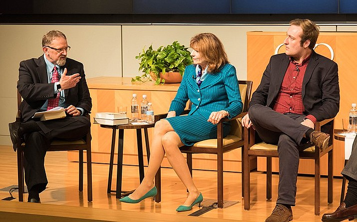 """The Cato Institute's Patrick Eddington asks ASU Professor Marianne Jennings about corporate whistleblowers as Irvin McCullough looks on. Jennins said of the White House whistleblower: """"If you're going to bring down the president, let's make sure you have evidence."""" (Photo by Lindsay Walker/Cronkite News)"""