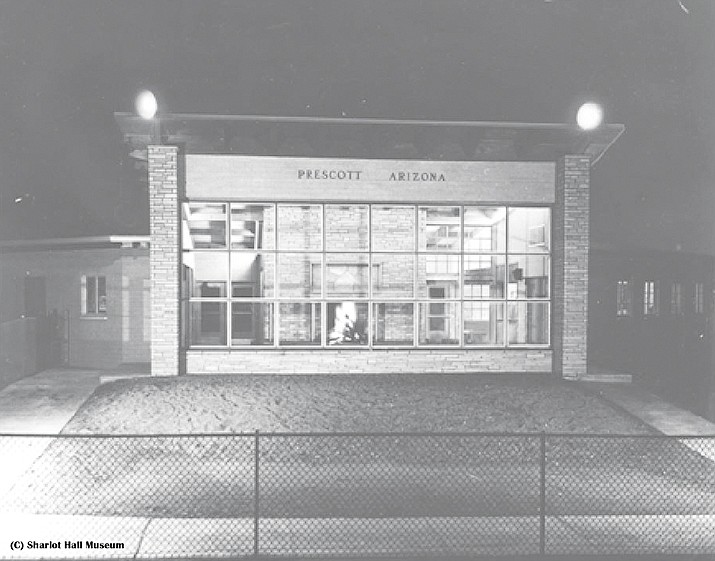 View of runway side of terminal at night, 1948. Note the inviting fire. (Image courtesy of Sharlot Hall Museum, Library & Archives.)