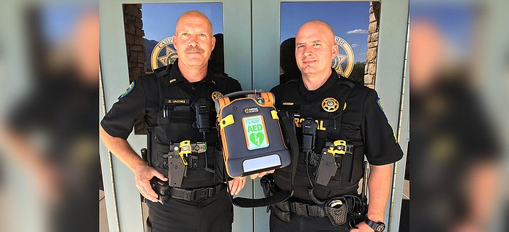 Daniel Jacobs, left, and Steve McClure, sergeants with the Camp Verde Marshal's Office, with an Automated External Defibrillator. Arizona Community Foundation of Sedona granted CVMO $1,875 toward the cost of two AEDs. VVN/Bill Helm