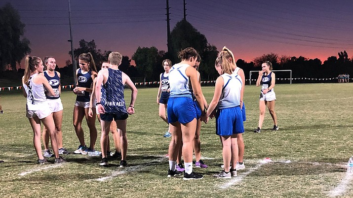 Camp Verde cross country runners huddle before the girls race at the Phoenix Classic - Showdown at Sundown at Crossroads Park in Gilbert on Friday night. Photo courtesy of David Castillo