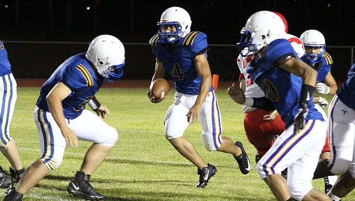 Austin Dias rushed for 96 yards and a touchdown Friday night in a 49-14 loss to River Valley. (Daily Miner file photo)