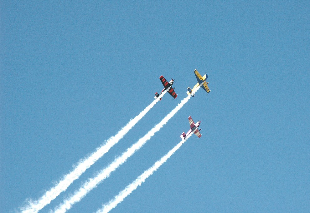 "Bill Stein, Rob Holland and Matt Chapman flying aerial acrobatics in formation as ""The Force"" during the 2019 Wings Out West Air Show at the Prescott Regional Airport Saturday, Oct. 5, 2019. (Jason Wheeler/Courier)"