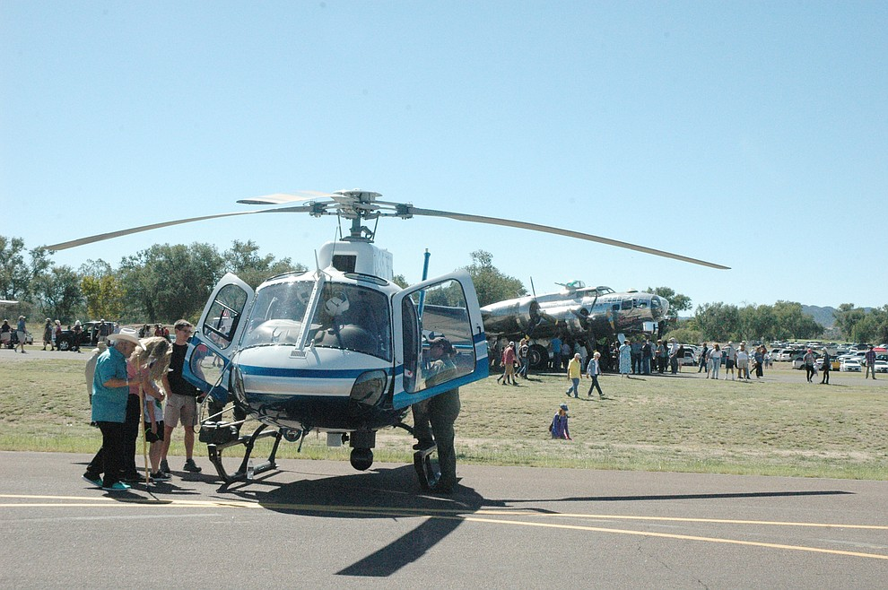 Attendees to the 2019 Wings Out West Air Show at the Prescott Regional Airport held Saturday, Oct. 5, enjoy static displays. (Jason Wheeler/Courier).