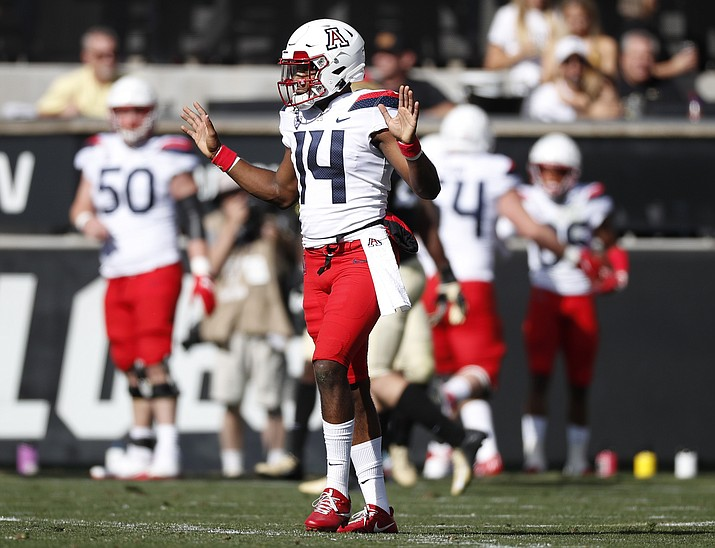 Arizona quarterback Khalil Tate, front, reacts after throwing for a touchdown against Colorado in the first half of a game Saturday, Oct. 5, 2019, in Boulder, Colo. (David Zalubowski/AP)