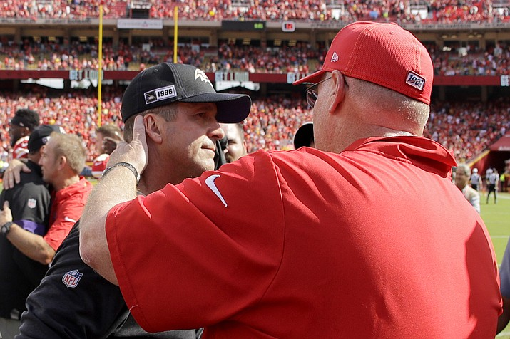 Kansas City Chiefs head coach Andy Reid, right, and Baltimore Ravens head coach John Harbaugh greet each other after their game Sunday, Sept. 22, 2019, in Kansas City, Mo. (Charlie Riedel/AP)