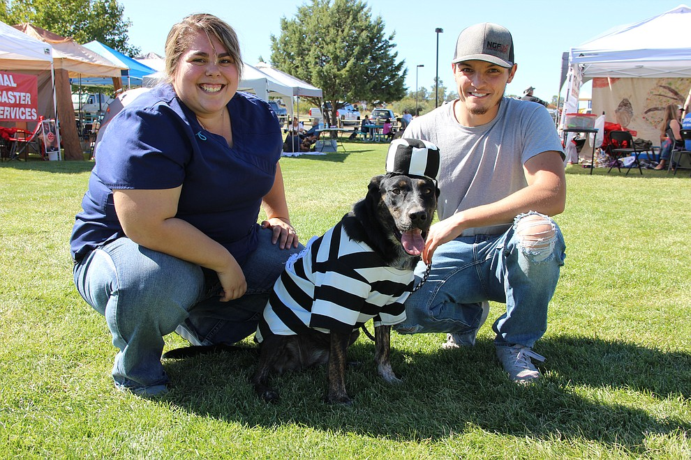 Mishelle and Dorian Jones with their dog, Seiki, dressed as a prison inmate at Watson Lake Park during Dogtoberfest Sunday, Oct. 6, 2019. The event included vendors, K-9 demonstrations, a costume contest, dog adoptions and much more. (Max Efrein/Courier)