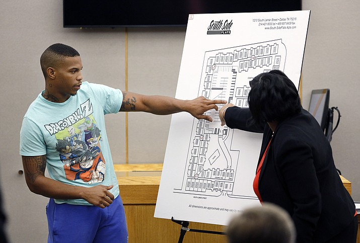 In this Tuesday, Sept. 24, 2019, photo, victim Botham Jean's neighbor Joshua Brown, left, answers questions from Assistant District Attorney LaQuita Long, right, while pointing to a map of the South Side Flats where he lives, while testifying during the murder trial of former Dallas Police Officer Amber Guyger, in Dallas. Authorities say that Brown was killed in a shooting Friday, Oct. 4. (Tom Fox/The Dallas Morning News via AP, Pool)