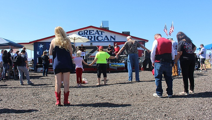 The Trumpstock festival in Golden Valley started with a prayer on Saturday, Oct. 5. (Photo by Agata Popeda/Kingman Daily Miner)